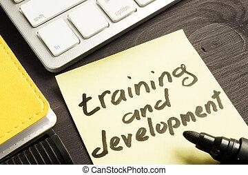 Training and development handwritten in a note.