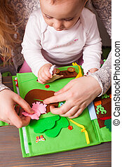 Training for young children with a handmade book