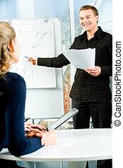 Training - Image of confident professional explaining his ...