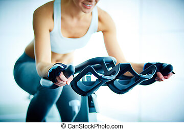 Training in gym - Close-up of young female training on...