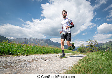 Training of a mountain marathon runner on the country road
