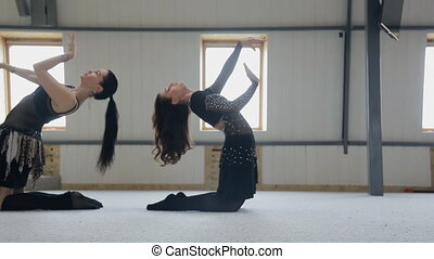 Training of oriental dance in dancing class at mirror.