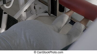 Training on back leg curl machine