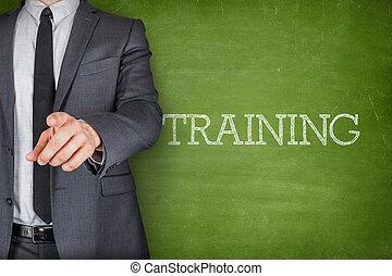Training on blackboard with businessman