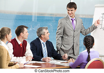Training - Group of business people listening to successful...