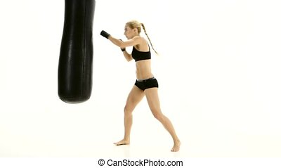 Training with a punching bag at the sportswoman boxer