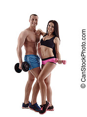 Training with dumbbells. Couple posing in studio