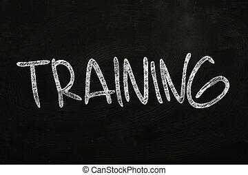 Training writing, written with Chalk on Blackboard