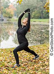 Training yoga in park