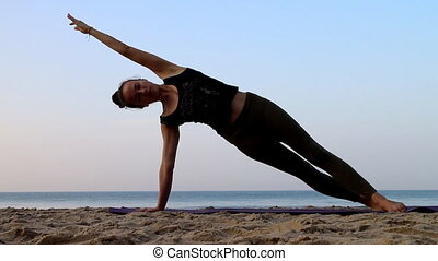 training yoga on the beach of the Indian ocean