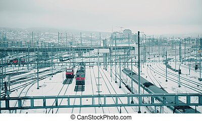 Trains and many railroad tracks in snow in Zurich, Switzerland