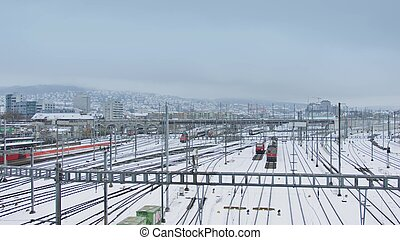 Trains and railroad tracks in snow
