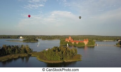 Trakai Castle and Lake Galve near Vilnius, Lithuania. The famous Vytautas castle, aerial view. Trakai medieval castle. A great example of masonry fortifications in the Middle Ages.