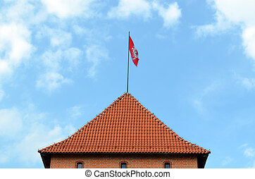 Trakai castle tower and flag flying on top