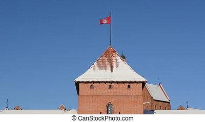 trakai castle tower flag - Red brick ancient architecture...