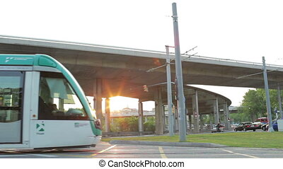 Tram is passing by at the sunset.