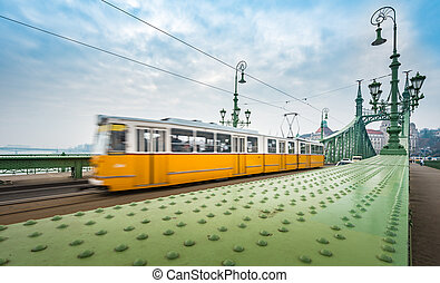 Tram on Liberty bridge in Budapest, Hungary.