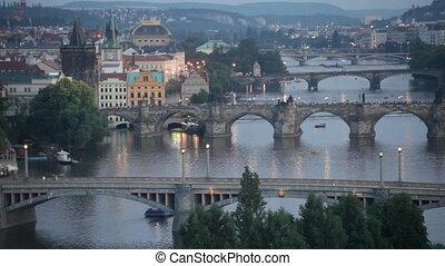 tram passes on the bridge through Vltava in Prague, the...