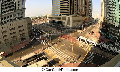 tram passing in traffic Dubai