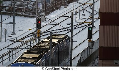 Tram passing through traffic light, Stockholm, Sweden