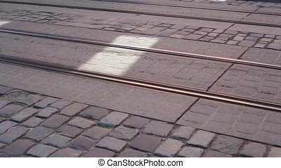 tram rides on rails