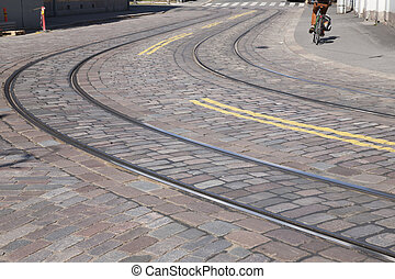 Tram Tracks with Cyclist in Helsinki,