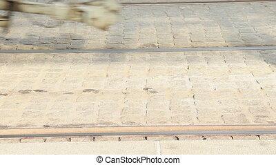 tram wheel - A blue low-floor tram arriving to a tram stop,...