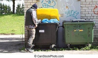 Tramp digging in dumpster - Tramp digging in dumpster