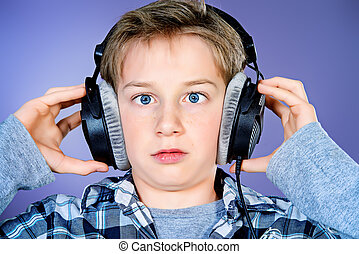 trance music - Funny teen boy listening to music in...
