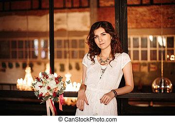 Tranquil bride posing in loft interior
