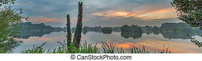 Tranquil evening lake reflection