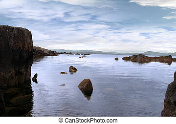 tranquil kerry view - scenic view in kerry ireland of rocks...