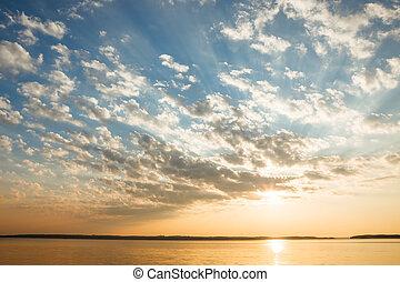 Tranquil lake scene at sunrise