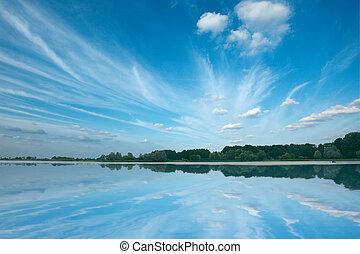 Tranquil lake with beautiful sky. Nesvizh, Belarus
