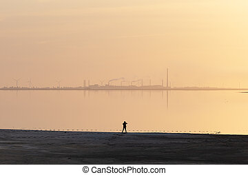 Tranquil minimalist landscape with lonely girl
