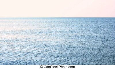 Tranquil morning sea. Blue sea water and white sky...
