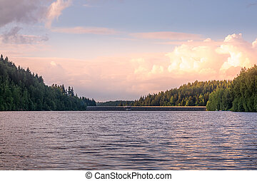 Tranquil mountain lake at sunset with reflections