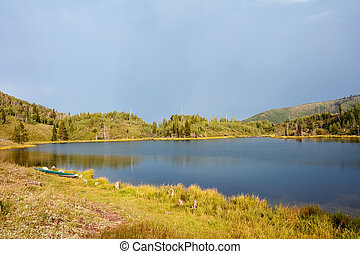 Tranquil mountain lake with reflections
