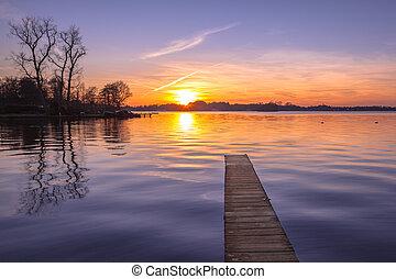 Tranquil purple Sunset over Serene Lake