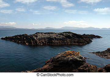 tranquil rocky islands - scenic view in kerry ireland of...