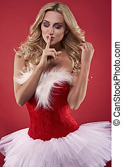 Tranquil scene of sexy santa on the red background
