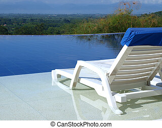 Seat besides a swimming pool