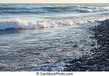 Tranquil waves on the beach against evening sky
