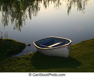 Tranquility at dawn - Boat on the shore at daybreak