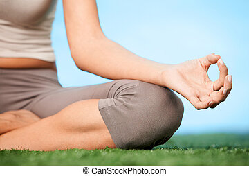 Tranquility - Close-up of female?s knee during meditation in...