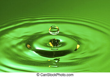tranquility conceptual. green droplet splash in a water
