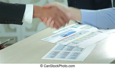 Transaction. Two Confident businessman shaking hands with...