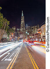 Transamerica Building and light trail at night. Cityscape...