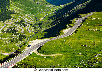 Transfagarasan mountain road in the valley, view from above....