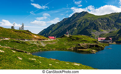 lake Balea in Fagaras mountains on a bright sunny day -...